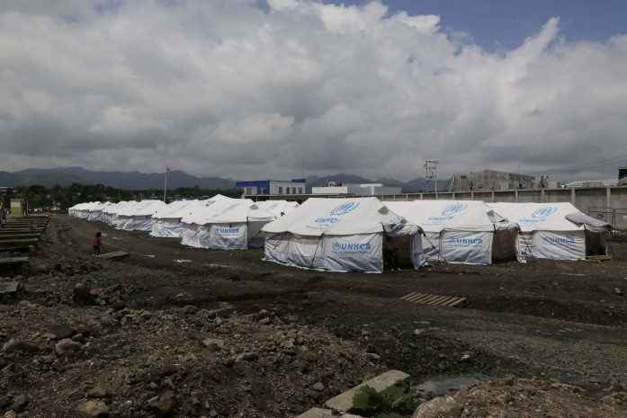 In this May 15, 2016 photo, tents set up for people displaced by last month's earthquake stand in rows at the new bus terminal in Pedernales, Ecuador. A month after the magnitude 7.8 earthquake many Ecuadorians are still struggling. (Dolores Ochoa/Associated Press)