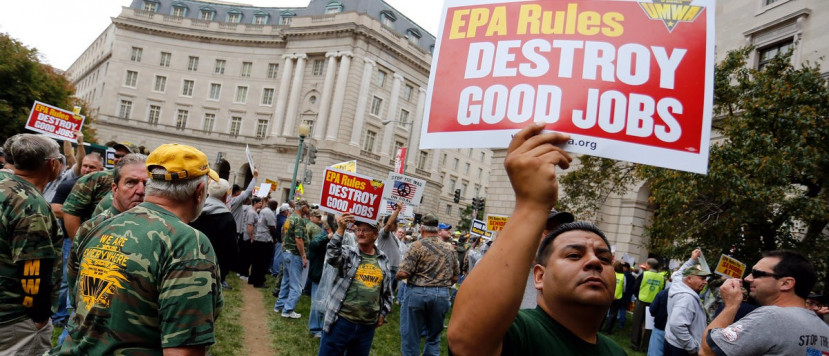 Members of the United Mine Workers of America hold a rally outside the U.S. Environmental Protection Agency headquarters in Washington October 7, 2014. The union members rallied against proposed EPA Clean Power Plan rules, which the union claims will eliminate thousands of coal industry-related jobs. REUTERS/Jonathan Ernst