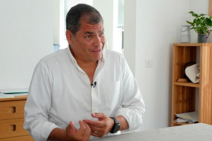 Former President of Ecuador, Rafael Correa reacts during an interview with The Associated Press, at his family home close to Brussels, Belgium, Thursday July 5, 2018. Correa called Ecuador's demand that he is extradited from Belgium and jailed, just a power ploy by the Ecuador government in an effort to stamp out opposition. (Mark Carlson/AP Photo)