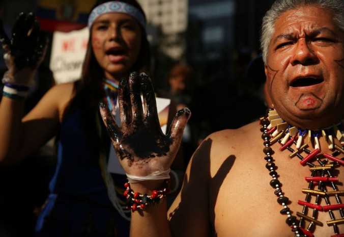 Protesters demonstrate in front of a United States courthouse against Chevron on Oct. 15, 2013 in New York City. Photo: Financial Post