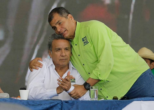 Ecuador's President Rafael Correa, right, embraces human rights activist and former vice president, Lenin Moreno, during the Alianza PAIS party convention where Moreno was tapped as the ruling party presidential candidate, in Quito, Ecuador, Saturday, Oct. 1, 2016. The elections for president and legislators are scheduled for Feb. 19, 2017. Dolores Ochoa AP
