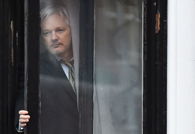 WikiLeaks founder Julian Assange steps out on the balcony of the Ecuadoran Embassy to address the media in London in February. (Ben Stansall/AFP via Getty Images)