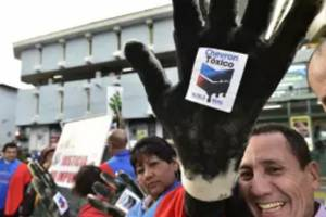 Activists protest against US multinational energy corporation Chevron at a square in Quito RODRIGO BUENDIA/Getty Images